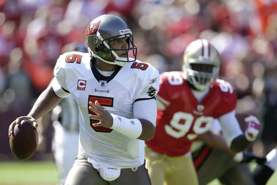 Tampa Bay Buccaneers quarterback Josh Freeman, left, as San Francisco 49ers linebacker Aldon Smith pursues during the second quarter of their NFL football game in San Francisco, Sunday, Oct. 9, 2011. (AP Photo/Ben Margot) Photo: Ben Margot / AP