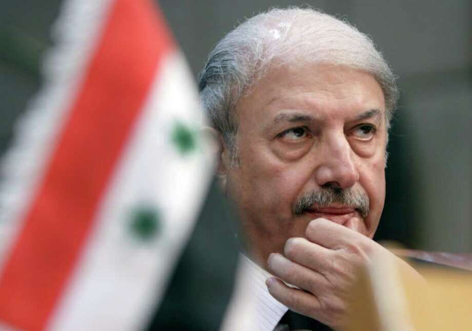 ASSOCIATED PRESS BAD DAY: Yussef al-Ahmad, Syria's ambassador to the Arab League, has little to say during Saturday's emergency session on Syria in Cairo. Photo: Amr Nabil / AP