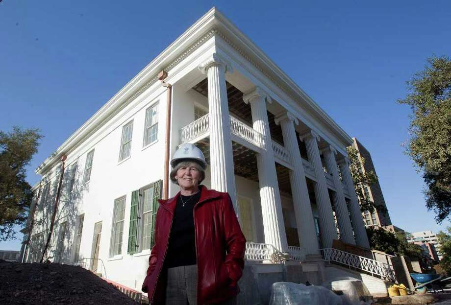 Dealey Herndon, 64, who is the site manager for the 155-year-old governor's mansion, stands in front of the mansion in Austin. The mansion is about six months away from being ready for the Perry's to move back in. In June 2008, an arsonist through a Molotov cocktail onto the front door of the mansion causing millions in fire, smoke and water damage. Photo: Johnny Hanson, Houston Chronicle / © 2011 Houston Chronicle