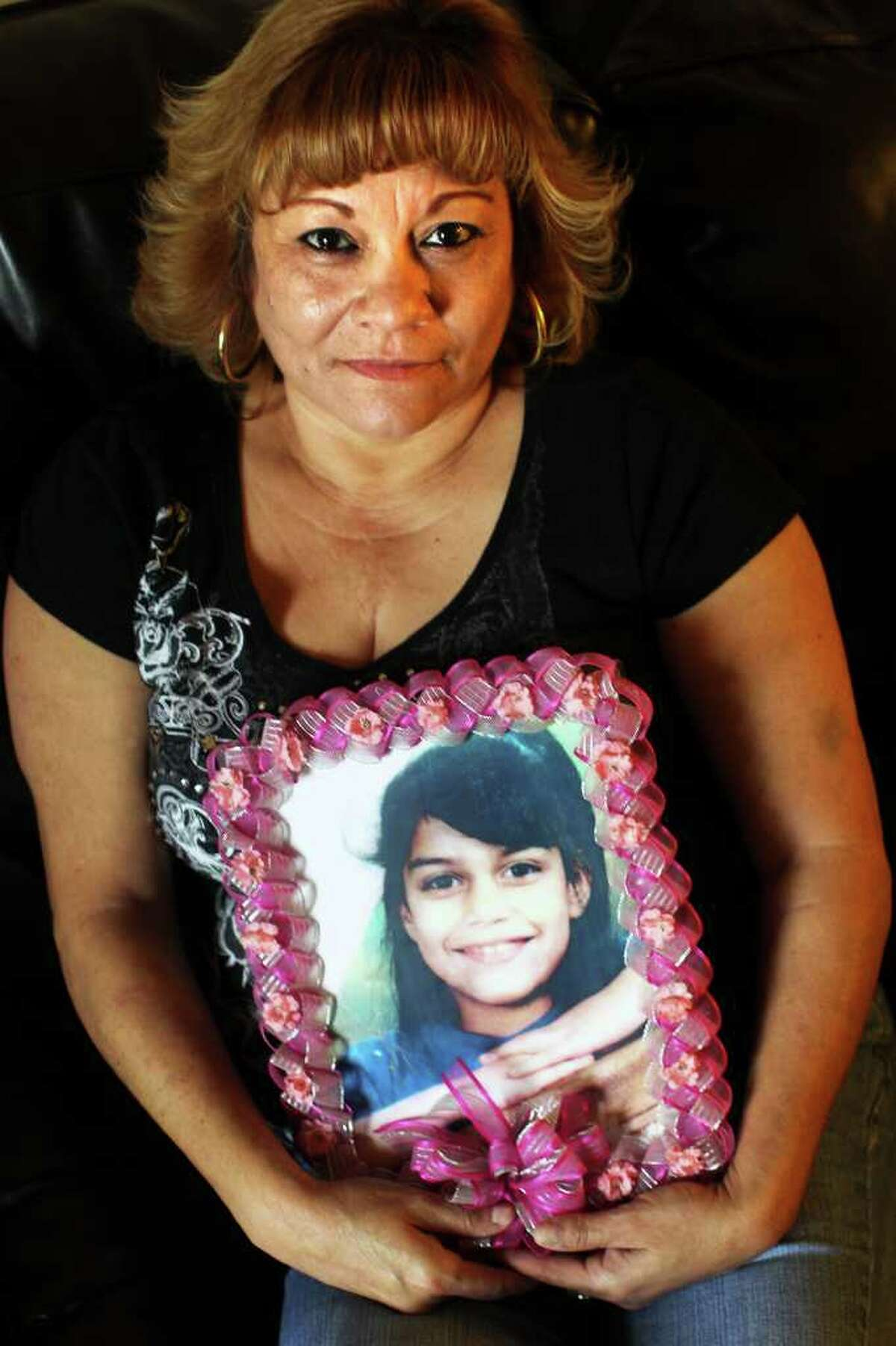 Diana Berlanga, whose 7-year-old daughter Alyssa Vasquez was raped and strangled to death in 1999, is shown at her home. Guadalupe Esparza was convicted in the capital murder and is set to be executed.