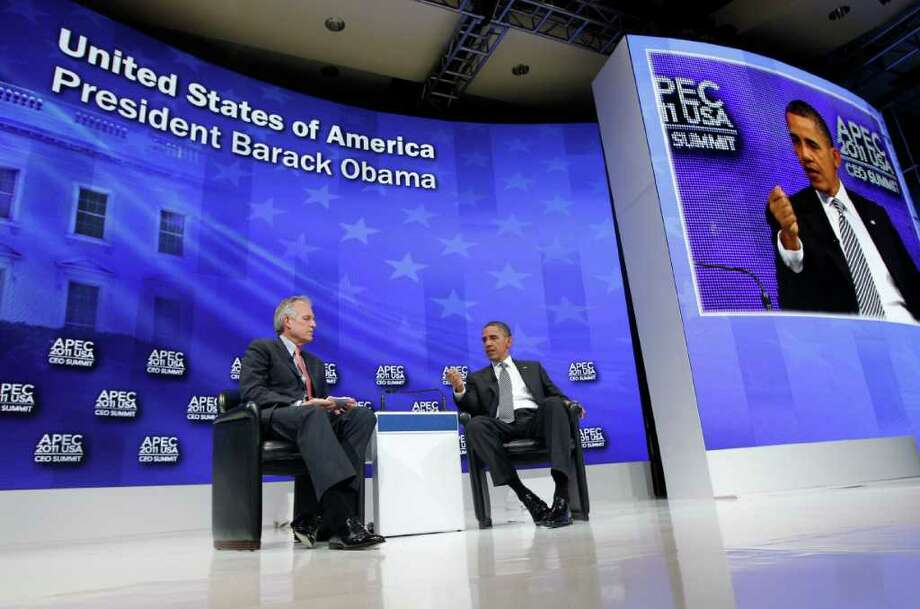 President Barack Obama answers questions at the APEC CEO Summit with Boeing Chief Executive Officer Jim McNerney in Honolulu, Hawaii on Saturday, Nov. 12, 2011. (AP Photo/Charles Dharapak) Photo: Charles Dharapak / AP
