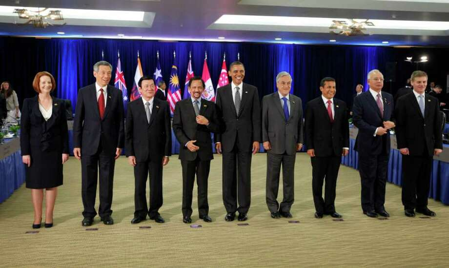 President Barack Obama meets with Trans-Pacific Partnership leaders during the APEC summit in Honolulu, Hawaii, Saturday, Nov. 12, 2011. Pictured from left to right are Australian Prime Minister Julia Gillard, Singaporean Prime Minister Lee Hsien Loong, Vietnamese President Truong Tan Sang, Sultan of Brunei Hassanal Bolkiah, Obama, Chilean President Sebastian Pinera, Peruvian President Ollanta Humala, Malaysian Prime Minister Abdul Razak and New Zealand Deputy Prime Minister Bill English. (AP Photo/Charles Dharapak) Photo: Charles Dharapak / AP