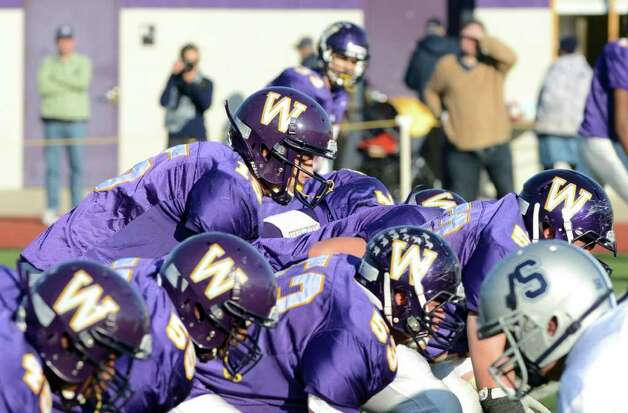Westhill's quarterback Peter Cernansky (15) on the line during the football game against Staples at Westhill High School on Saturday, Nov. 12, 2011. Photo: Amy Mortensen / Connecticut Post Freelance