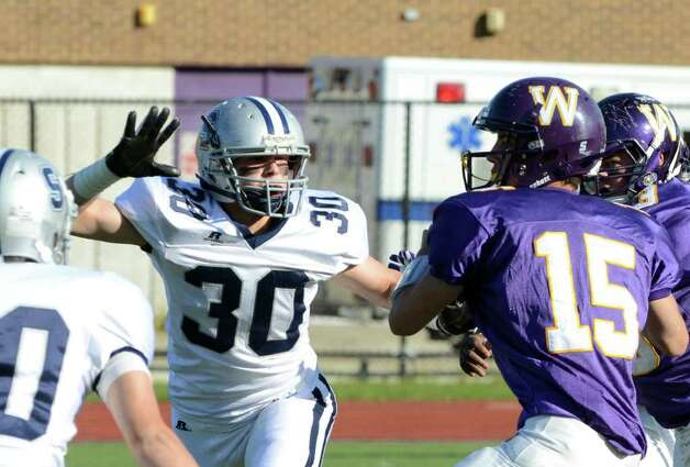 Staples' Mergim Trdevaj (30) defends against Westhill's quarterback Peter Cernansky (15) during the football game at Westhill High School on Saturday, Nov. 12, 2011. Photo: Amy Mortensen / Connecticut Post Freelance