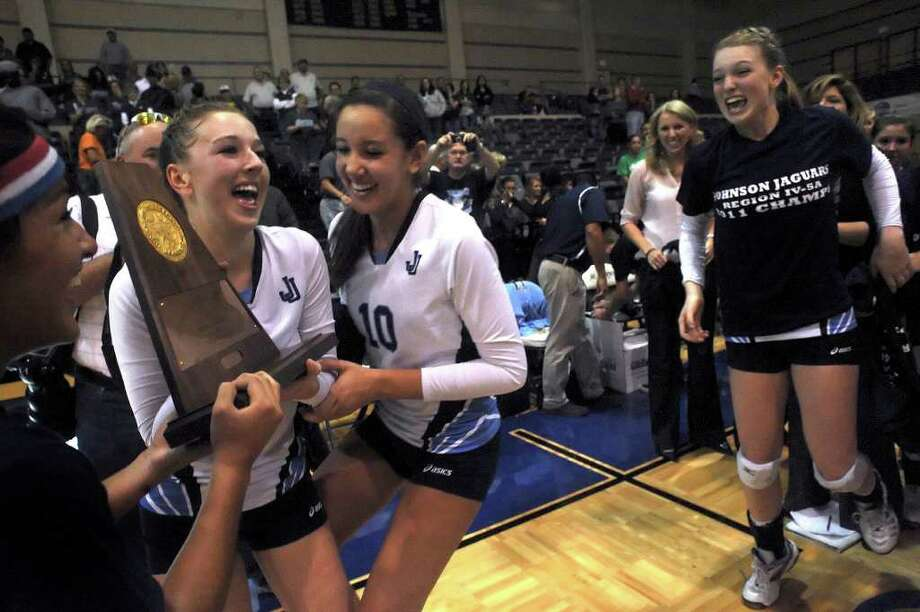 Jessica Teel and Alexis Guillory celebrate with teammates after winning the Region IV-5A volleyball tournament at Greehey Arena on Saturday, Nov. 12, 2011. BILLY CALZADA / gcalzada@express-news.net  Reagan vs. Johnson Photo: BILLY CALZADA, Express-News / gcalzada@express-news.net