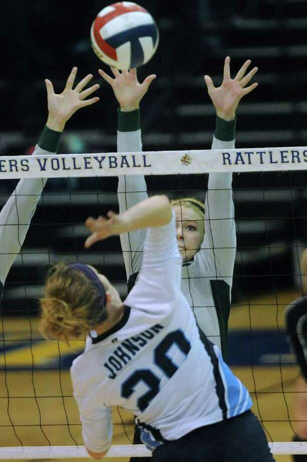 Brooke Sassin of Reagan prepares to block a spike by Olivia Drummond of Johnson during Region IV-5A volleyball tournament action at Greehey Arena on Saturday, Nov. 12, 2011. BILLY CALZADA / gcalzada@express-news.net  Reagan vs. Johnson Photo: BILLY CALZADA, Express-News / gcalzada@express-news.net
