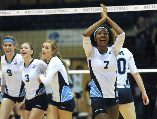 Carnae Dillard (7) of Johnson High School celebrates after a game three victory over Reagan in their best-of-five match during Region IV-5A volleyball tournament action at Greehey Arena on Saturday, Nov. 12, 2011. BILLY CALZADA / gcalzada@express-news.net  Reagan vs. Johnson Photo: BILLY CALZADA, Express-News / gcalzada@express-news.net