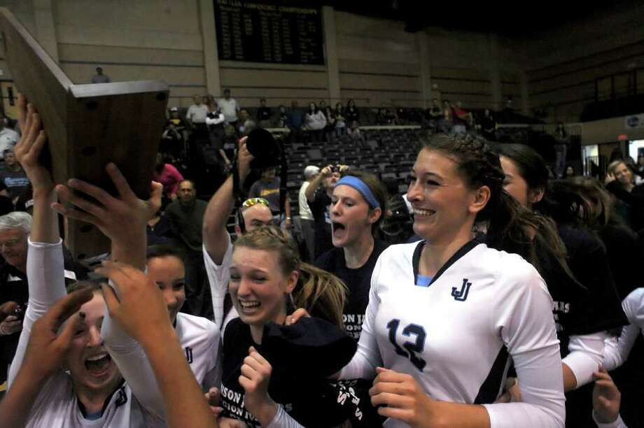 The Johnson girls volleyball team celebrates after defeating Reagan in the final game of the Region IV-5A volleyball tournament at Greehey Arena on Saturday, Nov. 12, 2011. BILLY CALZADA / gcalzada@express-news.net  Reagan vs. Johnson Photo: BILLY CALZADA, Express-News / gcalzada@express-news.net