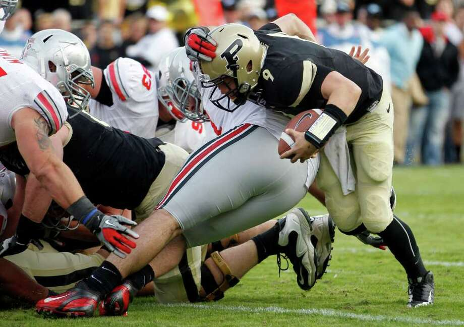 Purdue QB Robert Marve scores the game-winning touchdown to vanquish Ohio State. Photo: AP