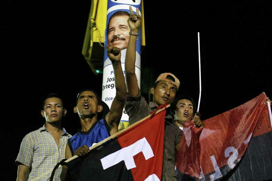 JEFFREY ARGUEDAS: EFE/ZUMA PRESS/McCLATCHY NEWSPAPERS  AFTER THE LANDSLIDE: Supporters of Daniel Ortega celebrate his victory in Nicaragua's Nov. 6 election. Many former comrades, however, now fear he has become a dictator. Photo: Jeffrey Arguedas / Zuma Press