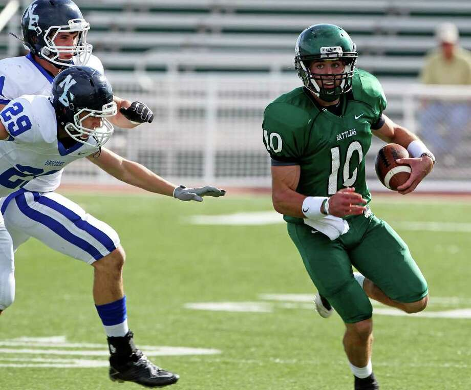 Rattler quarterback Trevor Knight sprints away from Unicorn defenders as Reagan plays New Braunfels at Farris Stadium in the first round of playoff action on November 12, 2011.  Tom Reel/Staff Photo: TOM REEL, Express-News / © 2011 San Antonio Express-News
