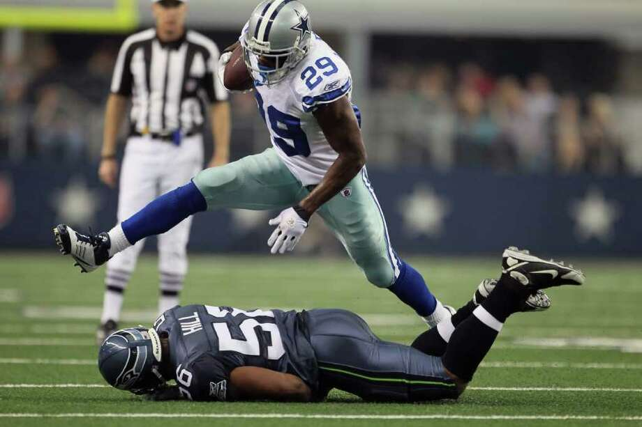 LEAPING TO NEXT LEVEL: Cowboys rookie running back DeMarco Murray (29) has rushed for a team-record 466 yards in a three-game span. Photo: Jeff Gross / 2011 Getty Images