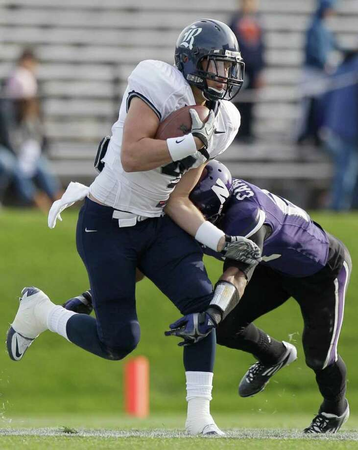 Rice wide receiver Randy Kitchens (4) is tackled by Northwestern defensive back Ibraheim Campbell (24) in the second half of an NCAA college football game Saturday, Nov. 12, 2011, in Evanston, Ill.  Northwestern won 28-6. (AP Photo/Nam Y. Huh) Photo: Nam Y. Huh, Associated Press / AP