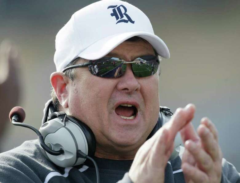 Rice head coach David Bailiff yells to his team in the first half of an NCAA college football game a