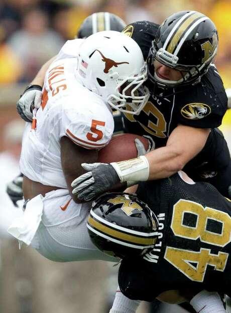 SHANE KEYSER: McCLATCHY-TRIBUNE GOING NOWHERE: Texas running back Jeremy Hills is dropped for a loss by Luke Lambert, top, and Andrew Wilson. Photo: Shane Keyser / Kansas City Star