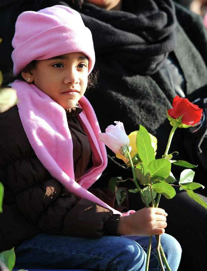 Makayla Perreauz, 6, of the Bronx, N.Y. holds flowers in remembrance of her great uncle, Luis Gustavo Perreaux during the Flight 587 Tenth Anniversary Memorial on Saturday, Nov. 12, 2011, in Belle Harbor in the borough of Queens, N.Y. Perreaux was one of the 265 people killed when the American Airlines airplane that was bound for the Dominican Republic crashed in Belle Harbor. (AP Photo/Kathy Kmonicek) Photo: Kathy Kmonicek