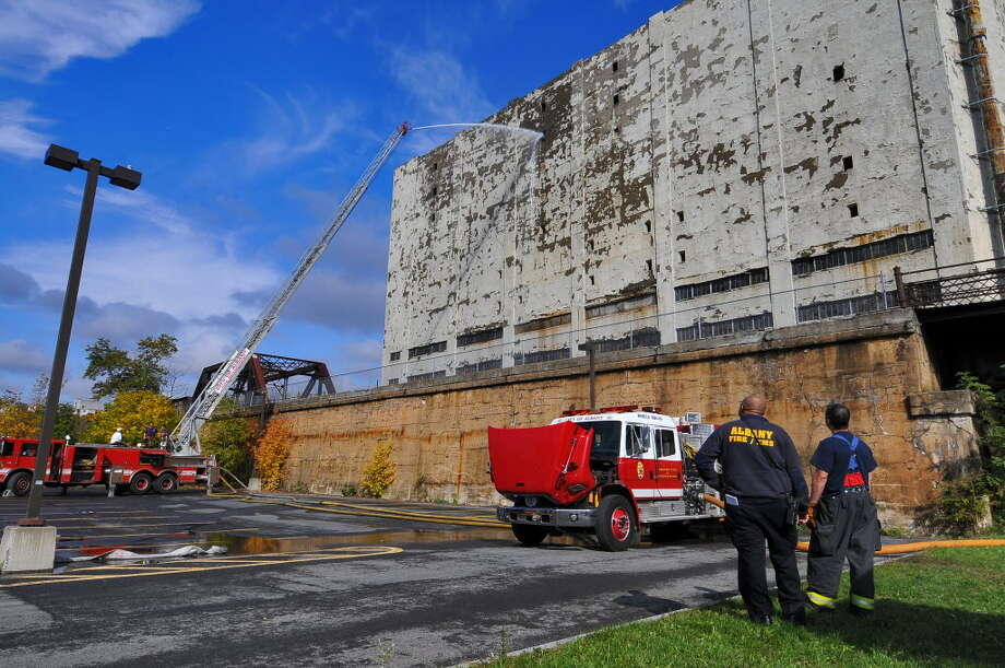 Albany firefighters train water again on the Central Warehouse building in Albany, on Tuesday afternoon October 26, 2010. The building caught fire on Friday. ( Philip Kamrass / Times Union )
