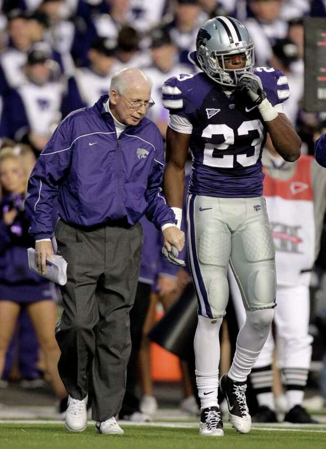 Kansas State defensive back Emmanuel Lamur (23) is helped off the field by head coach Bill Snyder after being hurt during the fourth quarter of an NCAA college football game against Texas A&M Saturday, Nov. 12, 2011, in Manhattan, Kan. Kansas State won the game 53-50 in quadruple overtime. (AP Photo/Charlie Riedel) Photo: Charlie Riedel, Associated Press / AP