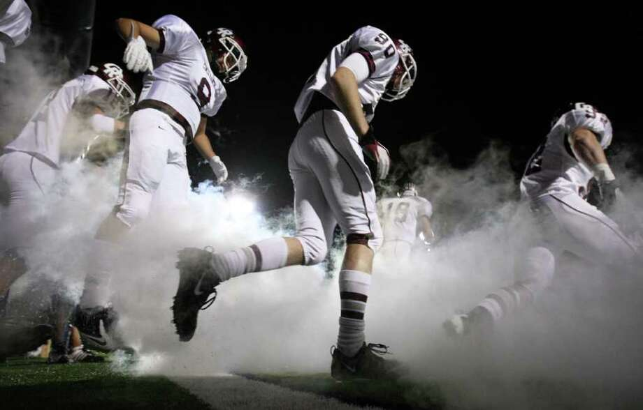 The Cinco Ranch Cougars take the field to face the Bellaire Cardinals for a high school football playoff game, Saturday, November 1, 2011 at Tully Stadium in Houston. Photo: Eric Christian Smith, For The Chronicle
