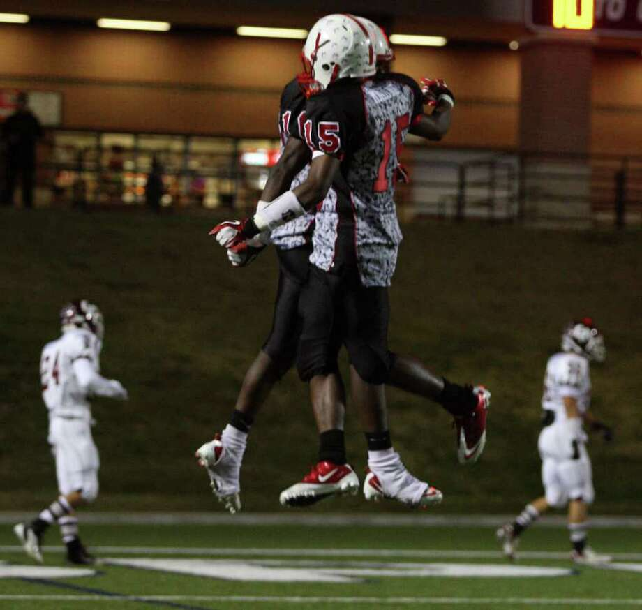 Bellaire's Devin Lauderdale (10) celebrate his 64-yard touchdown with teammate Ryheem Malone during the first half of a high school football playoff game against Cinco Ranch, Saturday, November 1, 2011 at Tully Stadium in Houston. Photo: Eric Christian Smith, For The Chronicle