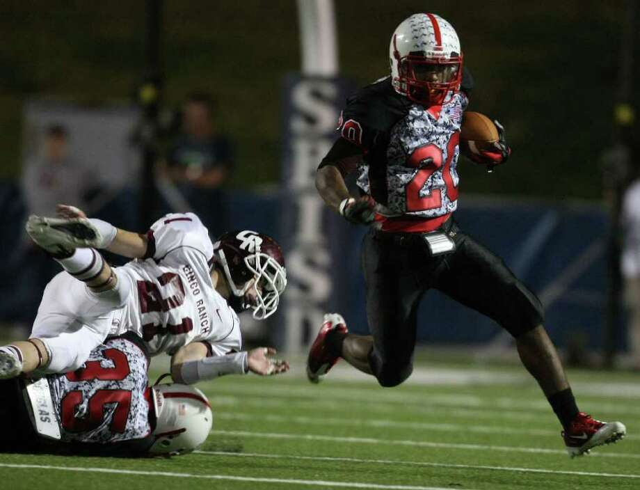 Bellaire's Denzel Johnson (20) scampers past Cinco Ranch's Russell Cuellar (21) during the first half of a high school football playoff game, Saturday, November 1, 2011 at Tully Stadium in Houston. Photo: Eric Christian Smith, For The Chronicle