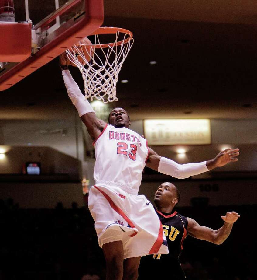Nov. 12: UH 88, Grambling State 42. UH's Jonathon Simmons #23 drives to the basket over Grambling's Bryant Purvis #11 in the first half. Photo: Bob Levey, Houston Chronicle / ©2011 Bob Levey