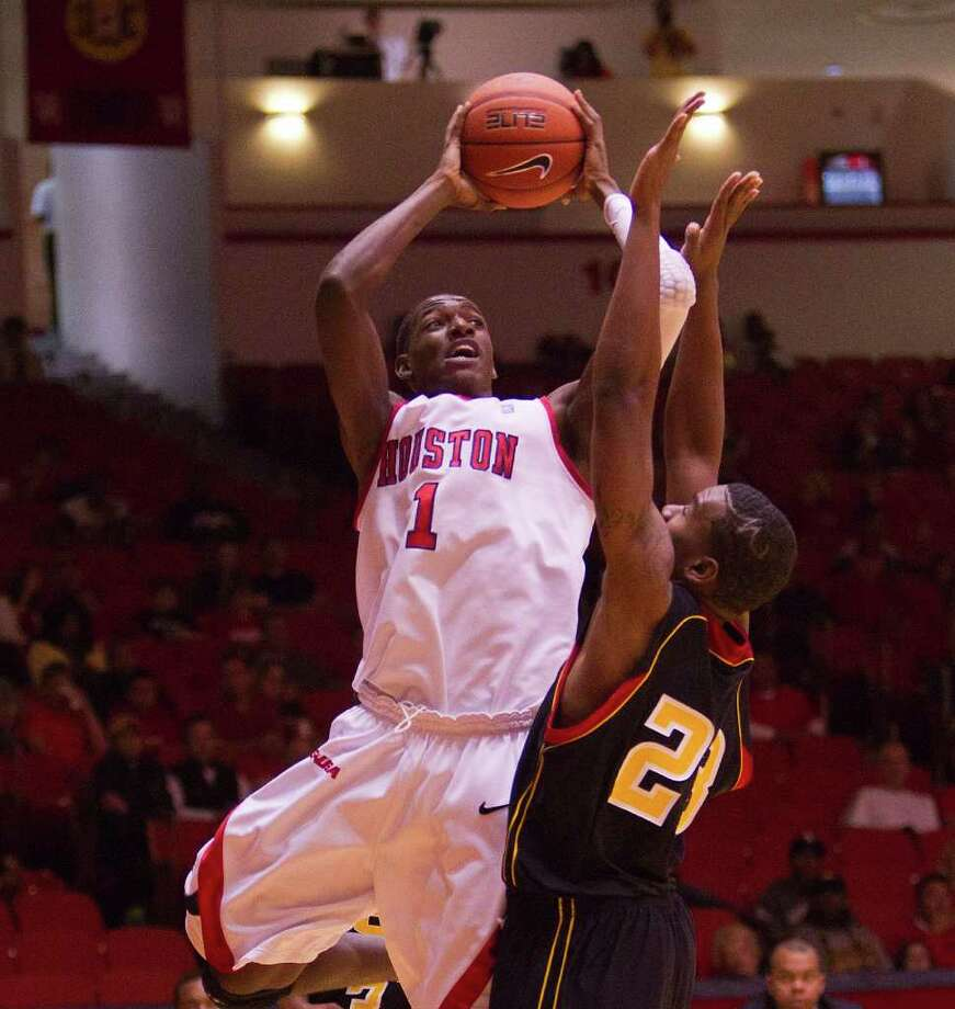 Houston's Mikhail McLean #1 shoots baseline over Grambling's Demetri Wheeler #23 during a NCAA basketball game between the Grambling State Tigers and the Houston Cougars November 12, 2011 at Hofheinz Pavilion in Houston, Texas. Photo: Bob Levey, Houston Chronicle / ©2011 Bob Levey