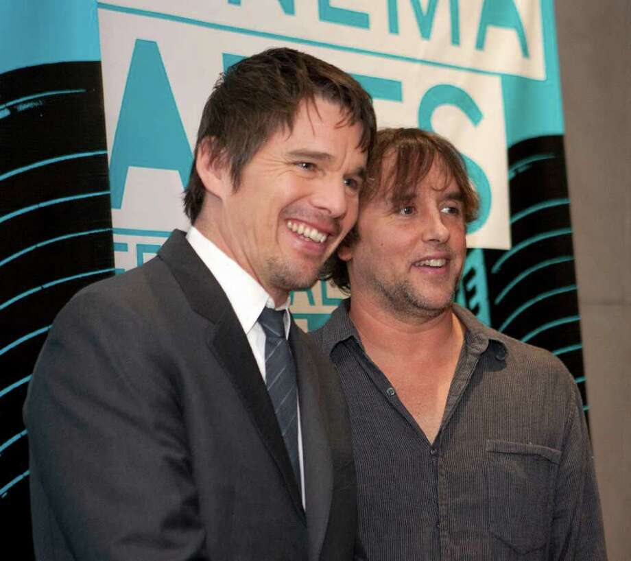 JAMES NIELSEN : CHRONICLE TOGETHER AGAIN: Past collaborators Ethan Hawke left, Rick Linklater arrive Saturday at the Museum Fine Arts, Houston for a presentation at the 2011 Cinema Arts Festival Houston. Photo: James Nielsen / © 2011 Houston Chronicle