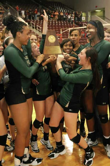 JERRY BAKER: FOR THE CHRONICLE TROPHY TIME: The state tournament-bound Cypress Falls Lady Eagles, including (from left) Chanel Clark-Bibbs, Alyssa La Mont, Erin Spivey, Maylan Eugene, Morgan Walsh and Alexis Austin, hoist their Region III-5A championship trophy. Photo: Jerry Baker