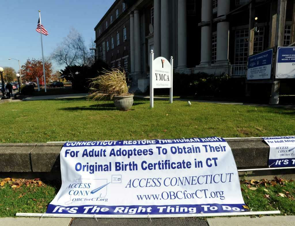 Demonstrators rally in greenwich for adoptee rights connecticut post an access connecticut banner in support of changing state law to restore the right for adult aiddatafo Image collections