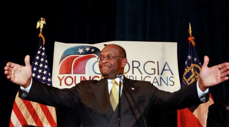 Republican presidential candidate Herman Cain speaks to the board of The Federation of Young Republicans Saturday, Nov. 12, 2011, in Atlanta. Cain has decried the media firestorm surrounding claims he sexually harassed former employees. But since the claims first surfaced Cain himself has been a constant media presence, appearing frequently on Fox News, visiting late-night talk shows and calling in to radio hosts. (AP Photo/John Bazemore) Photo: John Bazemore / AP