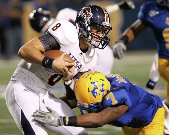 McNeese State's Brandon Robinson makes the tackle on Texas-San Antonio quarterback Eric Soza after a short gain Saturday night in Lake Charles, La. Photo: Brad Puckett / American Press