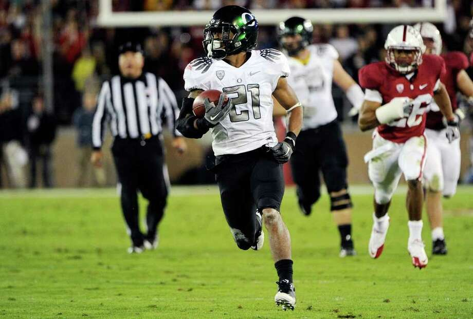 Thearon W. Henderson: Getty Images SPEED TO BURN: Oregon's LaMichael James completes a 58-yard touchdown run. Photo: Thearon W. Henderson / 2011 Getty Images