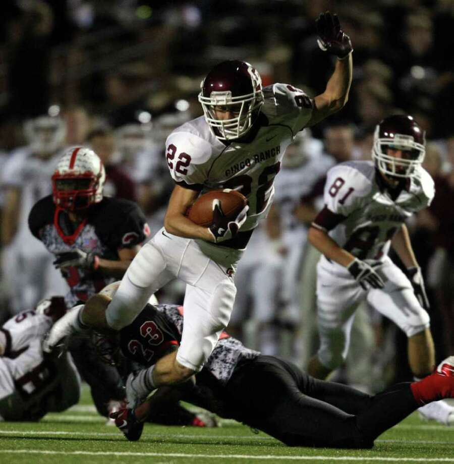 Nov. 12: Cinco Ranch 59, Bellaire 28.Cinco Ranch's Alex Ludowig (22) is tackled by Bellaire's Jacoby Pringle during the second half of a high school football playoff game, Saturday, November 12, 2011 at Tully Stadium in Houston. Photo: Eric Christian Smith, For The Chronicle