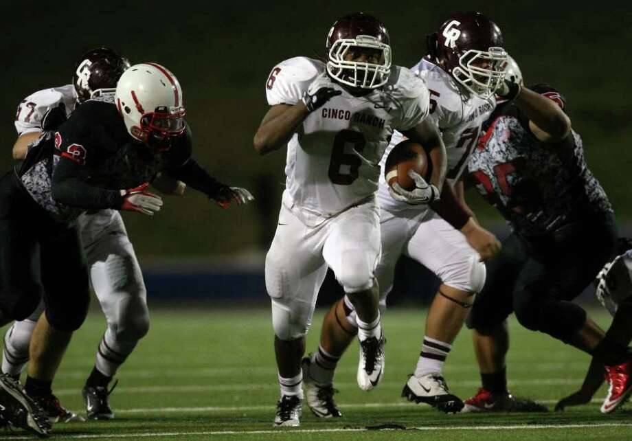 Cinco Ranch's Jamel James (6) breaks through the line of scrimmage en route to a 48-yard touchdown during the second half of a high school football playoff game, Saturday, November 1, 2011 at Tully Stadium in Houston. Photo: Eric Christian Smith, For The Chronicle