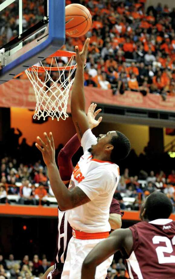 Syracuse's Kris Joseph scores against Fordham during the second half of an NCAA college basketball game in Syracuse, N.Y., Saturday, Nov. 12, 2011. Syracuse won 78-53. (AP Photo/Kevin Rivoli) Photo: Kevin Rivoli