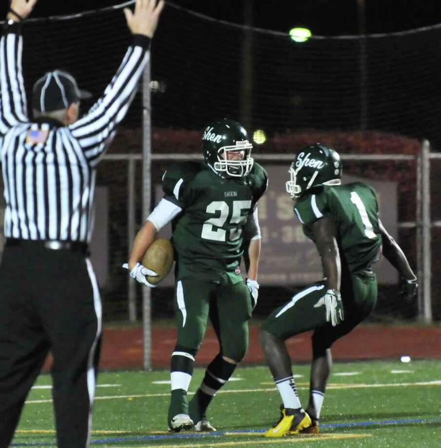 Shenendehowa's #25 Tony Fusco is congratulated by teammate #1 Jahlon Buchanan, at right, after Fusco's TD against North Rockland during the state Class AA quarterfinal football game at Dietz Stadium in Kingston Saturday Nov. 12, 2011.  (John Carl D'Annibale / Times Union) Photo: John Carl D'Annibale / 00015331A