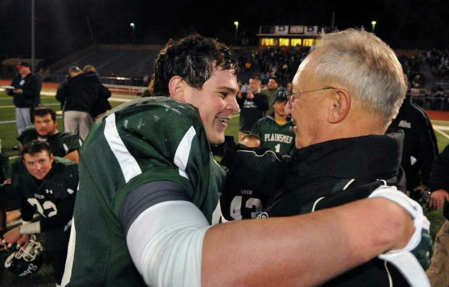 Shenendehowa's #25 Tony Fusco, left, and head coach Brent Steuerwald after Fusco's winning touchdown in double overtime against North Rockland during the state Class AA quarterfinal football game at Dietz Stadium in Kingston Saturday Nov. 12, 2011.  (John Carl D'Annibale / Times Union) Photo: John Carl D'Annibale / 00015331A