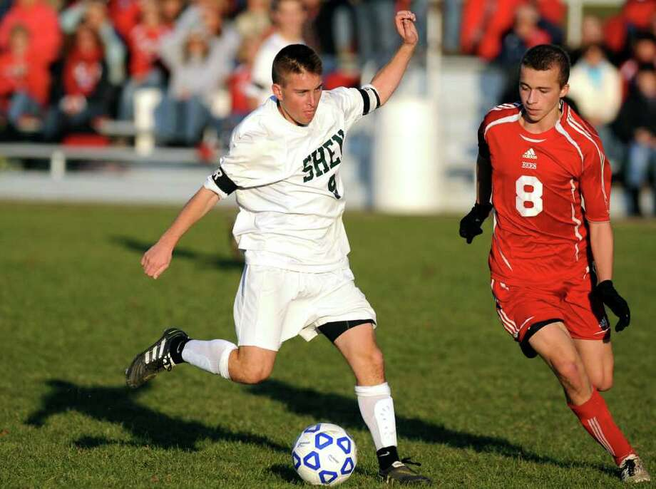 Shenendehowa's Adam Barlow (9), left, controls the ball as Baldwinsville's Andrew Annese (8) defends during their Class AA state soccer regional finals on Saturday, Nov. 12, 2011, at Colonie High in Colonie, N.Y. (Cindy Schultz / Times Union) Photo: Cindy Schultz / 00015369A