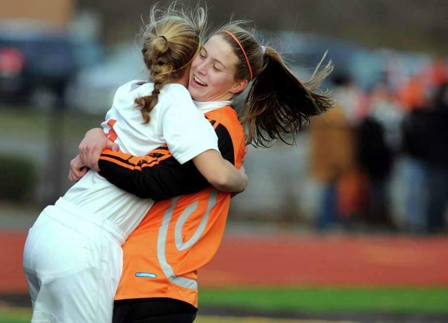 Bethlehem's keeper Katie Nickles, right, hugs teammate Liz Cultrara when they win 2-0 over Liverpool in their Class AA state soccer regional finals on Saturday, Nov. 12, 2011, Stillwater High in Stillwater, N.Y. (Cindy Schultz / Times Union) Photo: Cindy Schultz / 00015371A