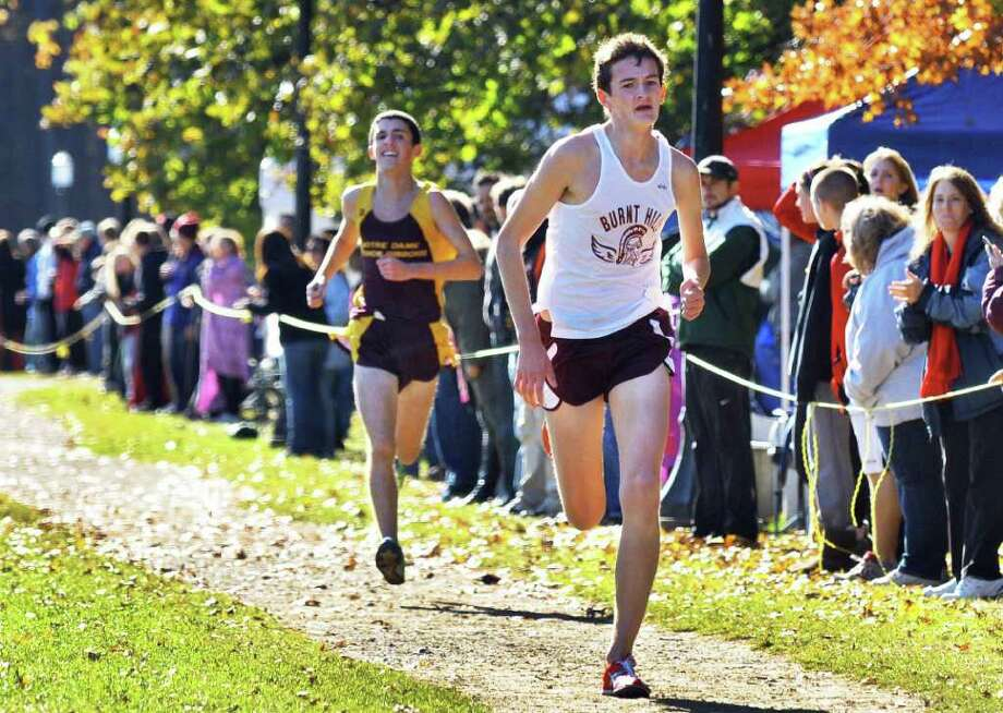 Burnt Hill's Buddy Herkenham, at right, holds off Bishop Gibbons' Jason Lange to win the Boys Class B Section II Cross Country Championship at Saratoga Spa State Park Friday Nov. 4, 2011.  (John Carl D'Annibale / Times Union) Photo: John Carl D'Annibale / 00015238A
