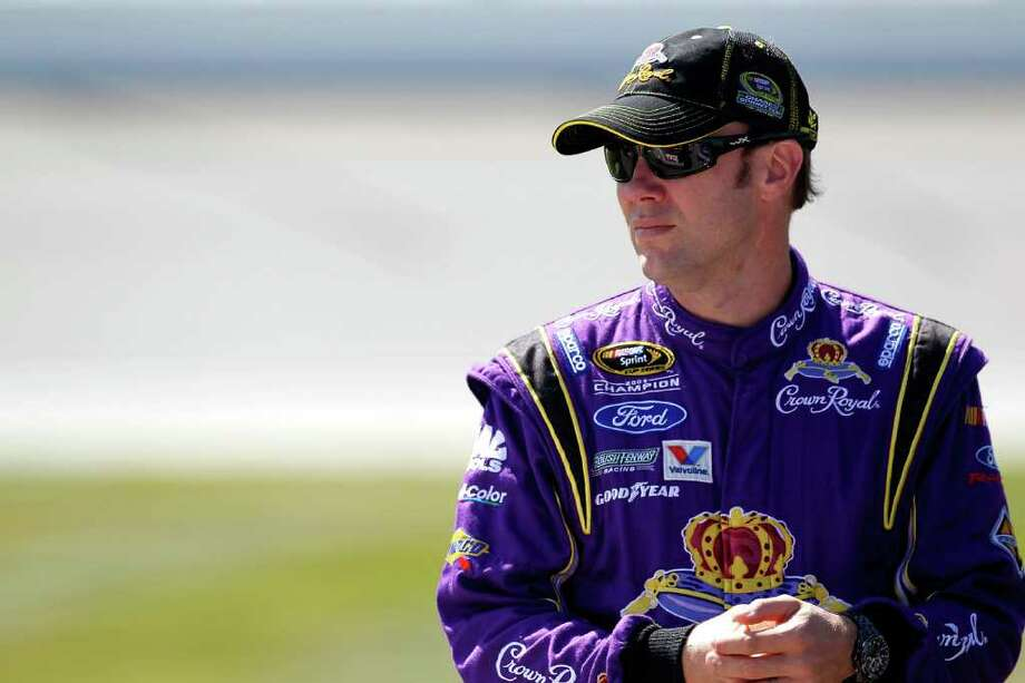 JOLIET, IL - SEPTEMBER 17:  Matt Kenseth, driver of the #17 Crown Royal Ford, stands on the grid during qualifying for the NASCAR Sprint Cup Series GEICO 400 at Chicagoland Speedway on September 17, 2011 in Joliet, Illinois.  (Photo by Geoff Burke/Getty Images for NASCAR) Photo: Geoff Burke / 2011 Getty Images