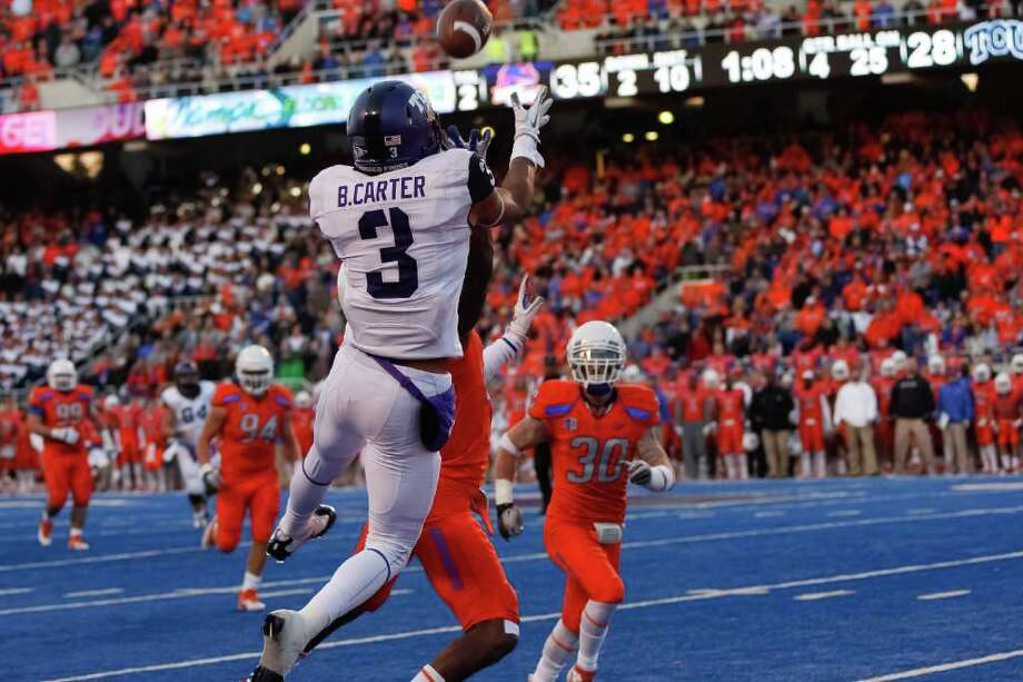 BOISE, ID - NOVEMBER 12:  Brandon Carter #3 of the TCU Horned Frogs makes a catch for a touchdown against the Boise State Broncos at Bronco Stadium on November 12, 2011 in Boise, Idaho.  (Photo by Otto Kitsinger III/Getty Images) Photo: Otto Kitsinger III