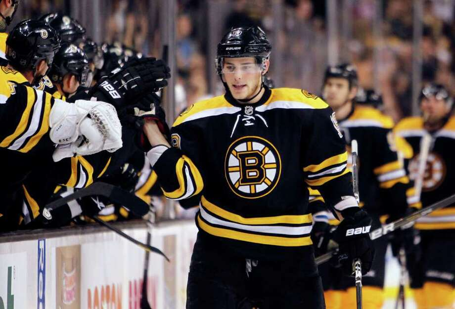 Boston Bruins' Tyler Seguin, center, celebrates his goal in the third period of an NHL hockey game against the Buffalo Sabres in Boston, Saturday, Nov. 12, 2011. The Bruins won 6-2. (AP Photo/Michael Dwyer) Photo: Michael Dwyer