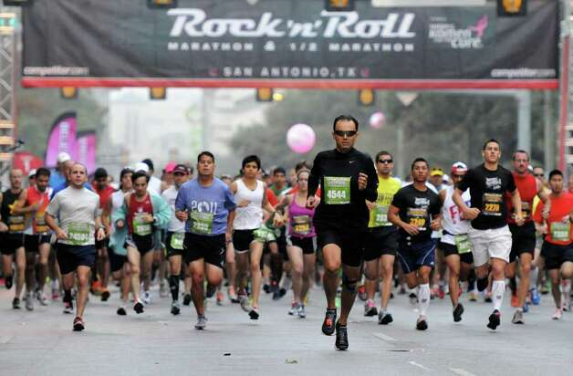 Some of the 23,822 runners who took part in the Rock 'n' Roll San Antonio Marathon & 1/2 Marathon begin their race. Photo: John Albright