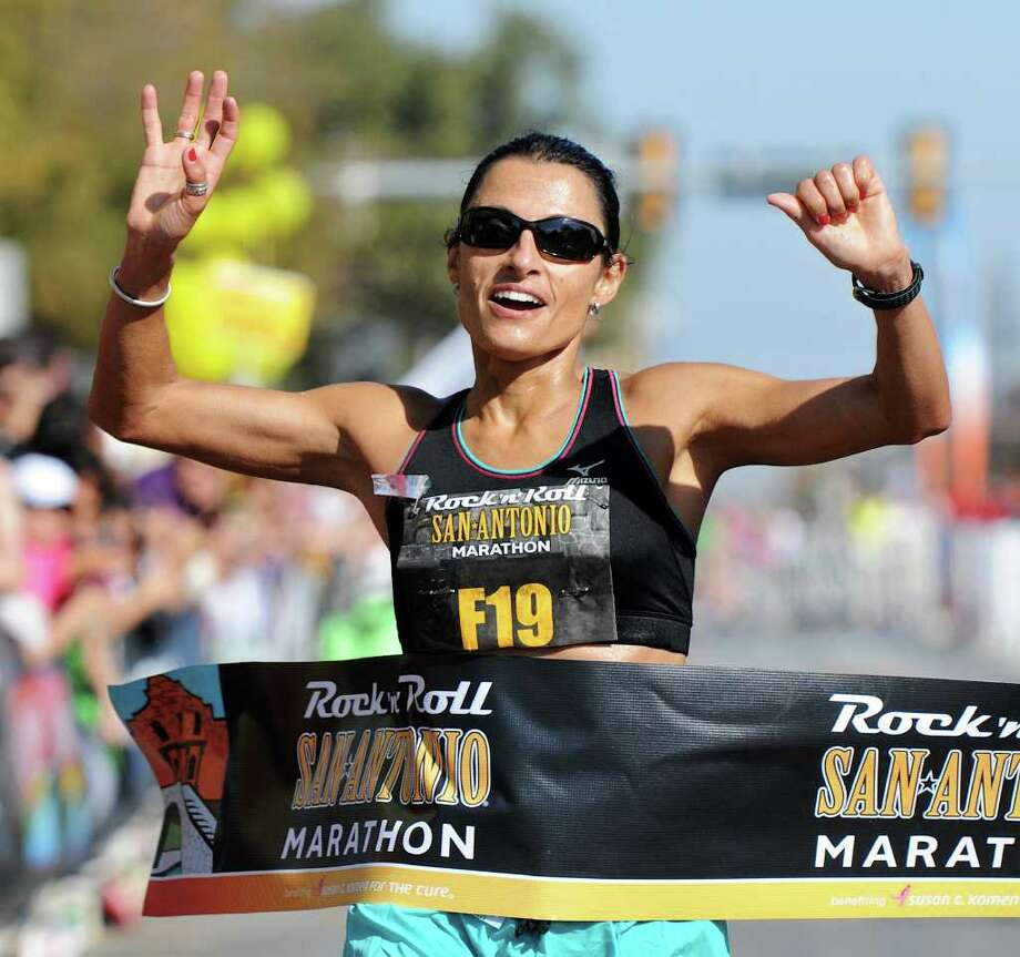 Liza Hunter-Galvan crosses the finish line in the 2011 San Antonio Rock 'n' Roll Marathon in San Antonio, Texas on November 13, 2011.
