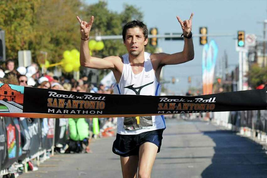 David Fuentes, a former standout in cross country at Boerne High School, crosses the finish line in first place during the 2011 San Antonio Rock 'n' Roll Marathon in San Antonio, Texas on November 13, 2011. John Albright / Special to the Express-News.