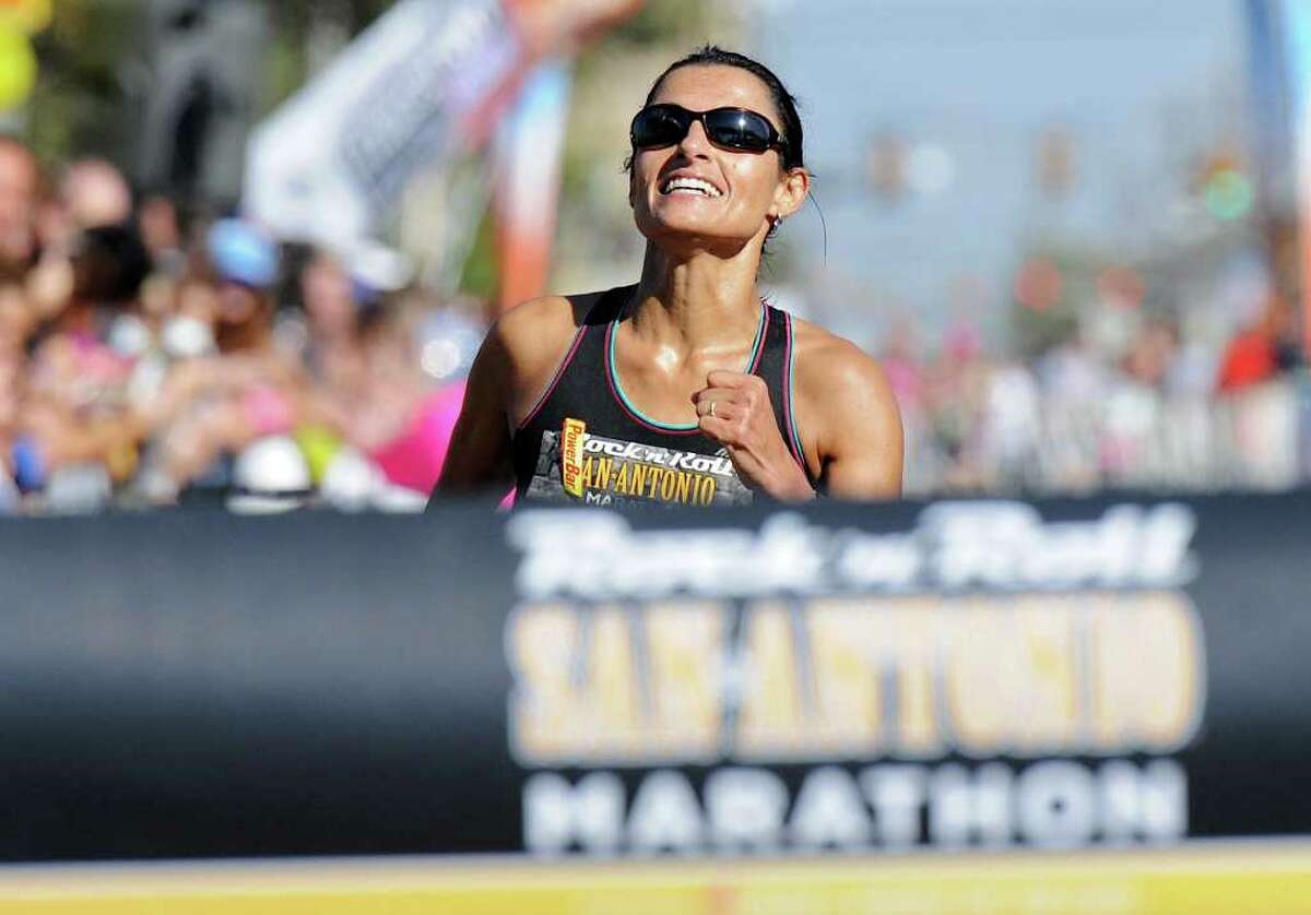 Liza Hunter-Galvan approaches the finish line during the Marathon run of the 2011 San Antonio Rock 'n' Roll Marathon and Half Marathon in San Antonio, Texas on November 13, 2011. John Albright / Special to the Express-News.