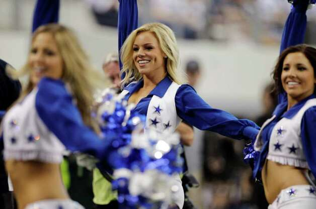 Dallas Cowboys cheerleaders, including Kelsi Reich, center, perform during the second half of the Cowboys' NFL football game against the Buffalo Bills on Sunday, Nov. 13, 2011, in Arlington, Texas. Reich's boyfriend, Bills' David Nelson, presented her with a football after he scored a touchdown during the first half of the game. Photo: AP