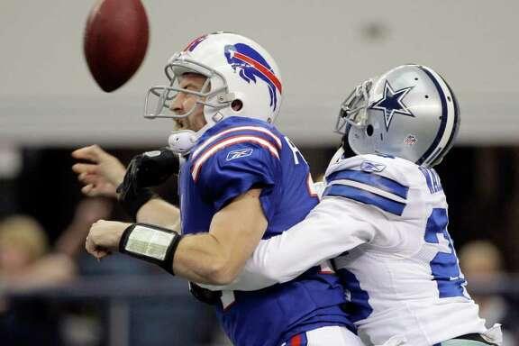 Dallas Cowboys' Frank Walker, right, sacks Buffalo Bills' Ryan Fitzpatrick during the first half of a NFL football game  Sunday, Nov. 13, 2011, in Arlington, Texas.